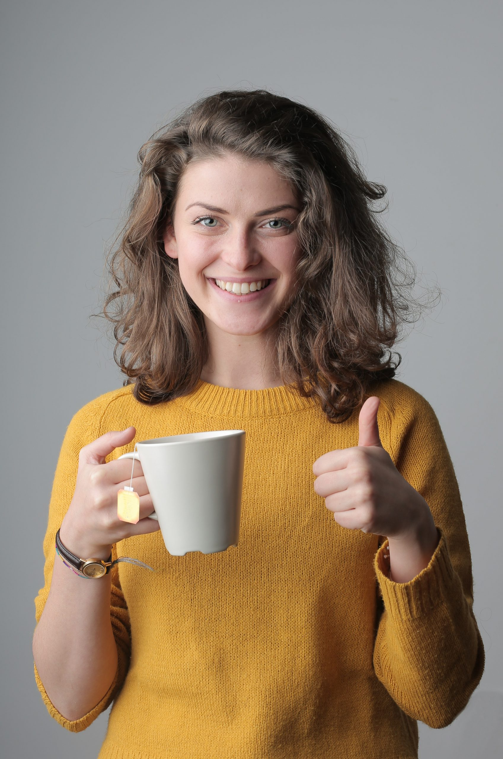 woman-in-yellow-sweater-holding-white-ceramic-mug-3979228